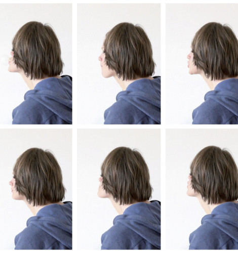 stills of the video sequence: Portrait of a Couple #1, 2011 / Two persons are arranged in front of the camera to appear as one. Here HE overlaps HER with his hair and sweater. HER face can be seen in action chewing a gum, trying to make bubbles. Played in Loop
